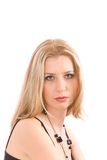 Portrait of blond over white. Portrait of blond in black dress and bead over white Royalty Free Stock Photos