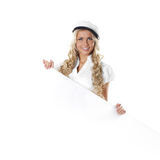 Portrait of a blond sailor woman holding a poster Royalty Free Stock Photo