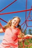 Portrait of blond smiling girl on net ropes Royalty Free Stock Images