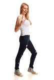 Portrait of blond teenage gesturing rock on Stock Photography