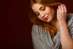 Portrait of blond winter beauty in light gray sweater Stock Image