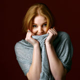 Portrait of blond winter beauty in light gray sweater Royalty Free Stock Images
