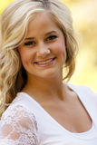 Portrait blond woman. Portrait of a pretty blond woman smiling royalty free stock images