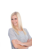 Portrait of Blond Woman with Arms Crossed. Waist Up Portrait of Smiling Blond Woman Wearing Grey T-Shirt with Arms Crossed in Studio with White Background Stock Images