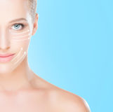 Portrait of a blond woman with arrows on her face Royalty Free Stock Photos