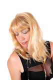 Portrait of blond woman in black dress. Royalty Free Stock Image