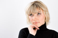 Portrait of blond woman in a black golf Stock Image