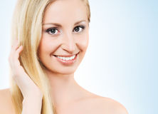 Portrait of a blond woman on blue Stock Images
