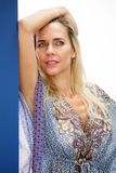Portrait of blond woman in blue dress Royalty Free Stock Photos