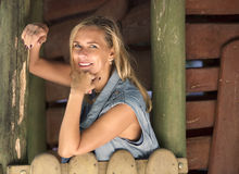 Portrait of blond woman at a cabin royalty free stock image