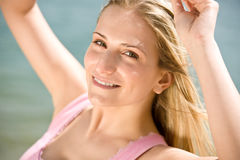 Portrait of blond woman enjoy summer sun Royalty Free Stock Image