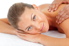 Portrait of blond woman enjoying a massage. Portrait of  blond woman enjoying a massage in a spa center Royalty Free Stock Photos