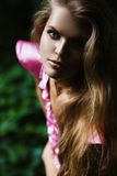 Portrait of blond woman in the evening. In dark forest Stock Photo