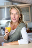 Portrait of blond woman with glass of juice Royalty Free Stock Photography