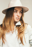 Portrait of blond woman in hat and denim shirt Stock Image