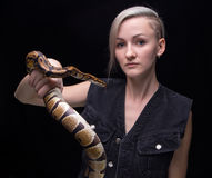 Portrait of blond woman holding python Royalty Free Stock Photography