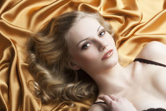 Portrait of blond woman laying, she looks in to th Royalty Free Stock Image