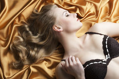 Portrait of blond woman laying, turned in profile Stock Image