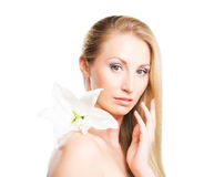 Portrait of a blond woman with a lily flower Stock Photography