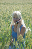 Portrait of blond woman phoning Royalty Free Stock Images