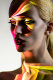 Portrait of blond Woman with shining lights on face Stock Images