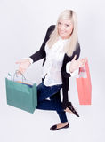 Portrait of a blond woman with shopping bags Stock Photo