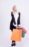 Portrait of a blond woman with shopping bags Royalty Free Stock Photo
