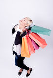 Portrait of a blond woman with shopping bags Royalty Free Stock Image