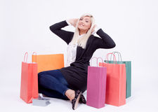 Portrait of a blond woman with shopping bags Stock Images