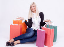 Portrait of a blond woman with shopping bags Royalty Free Stock Photography