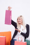 Portrait of a blond woman with shopping bags Royalty Free Stock Images
