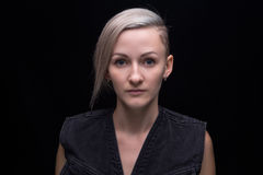 Portrait of blond woman with short hair. On black background royalty free stock image