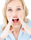 Portrait of a blond woman shouting at the camera Stock Photos