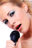 Portrait of blond woman singing Stock Photos