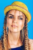 Portrait of blond woman in straw hat with plaits Stock Image
