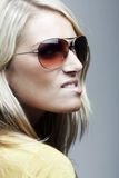 Portrait of a blond woman with sunglasses Royalty Free Stock Image