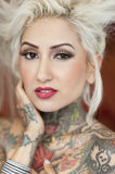 Portrait of blond woman with tattoos Stock Images