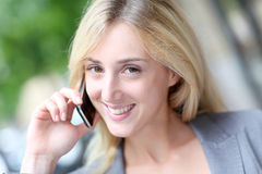 Portrait of blond woman with telephone Royalty Free Stock Images