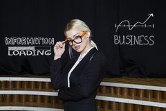 Portrait of a blond woman thinking about money-making. Business concept. Portrait of a blond woman in black suit thinking about money-making. Business concept Royalty Free Stock Image