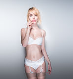 Portrait of Blond Woman Wearing White Lingerie Royalty Free Stock Images