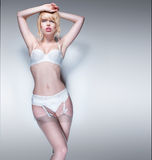 Portrait of Blond Woman Wearing White Lingerie Stock Photography