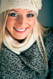 Portrait of blond woman in winter clothes Stock Images