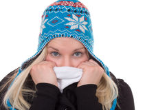 Portrait of blond woman in winter cold with cap and scarf Stock Photo