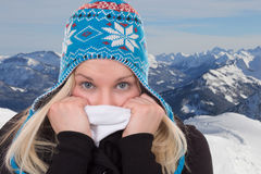 Portrait of a blond woman in winter cold in mountains Stock Images
