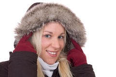 Portrait of a blond woman in winter with fur collar Stock Photos