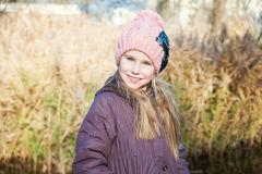Portrait of the blond young girl at autumn time reed background Stock Photo