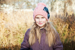 Portrait of the blond young girl at autumn time reed background stock images