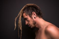 Portrait of a blonde boy with dreadlocks stock images