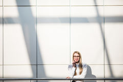 Portrait of blonde business woman in modern office Stock Images