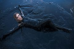Portrait of Blonde Caucasian Girl Lays Smeared in a Healthy Black Mud in old Firth. Portrait of Blonde Caucasian Girl Lays Smeared in a Healthy Black Mud in old royalty free stock images